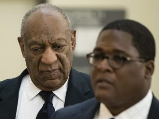 Bill Cosby (left) accompanied by publicist Andrew Wyatt, walks to the courtroom for his sexual assault trial at the Montgomery County Courthouse in Norristown, Pa., on June 13, 2017. (Matt Rourke/Associated Press, Pool)