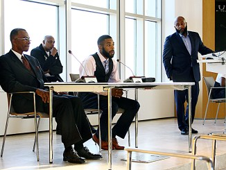 "Ivan Cloyd (center), 26, speaks on his experience as an 18-year-old father and the changes he's made over the years to better himself and his family. Cloyd was one of the panelists for the ""Voices from the Future"" Youth Town Hall meeting in northwest D.C. on June 15. (E Watson/EDI)"
