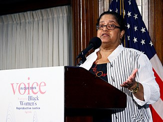 "Marcela Howell, founder and executive director of In Our Own Voice, presents the organization's ""Our Bodies, Our Lives, Our Voices"" report on June 27 at the National Press Club in Northwest. The report was released ""to put forward a policy, leadership, and movement building agenda"" for organizations working on women's issues specific to the black community. (E Watson/EDI)"