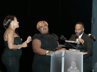"Joe Clair (right) of ""The Joe Clair Morning Show"" and Renee Allen (left) of the Women's Business Report present Dayonna Braddy with an award for her mini-documentary, ""The Perfect Child,"" during the 2017 Richard Wright Gala at the Warner Theater on June 10. (Shevry Lassiter/The Washington Informer)"