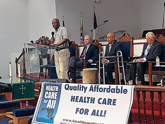 Prince George's County Executive Rushern L. Baker III (standing) speaks during a June 24 health care forum at Greater Mt. Nebo AME Church in Bowie. (William J. Ford/The Washington Informer)