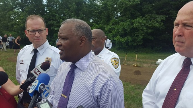Prince George's County Executive Rushern L. Baker III (center), along with Police Chief Hank Stawinski (left), speaks with reporters July 12 after a groundbreaking ceremony for a new public safety firearm and tactical training complex in Upper Marlboro. (William J. Ford/The Washington Informer)