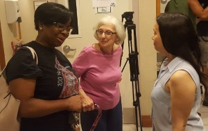 Denise Mitchell (left), former College Park councilwoman, chats with other residents on Aug. 8 after the city council postponed a plan on whether undocumented immigrants can vote in local elections. (William J. Ford/The Washington Informer)