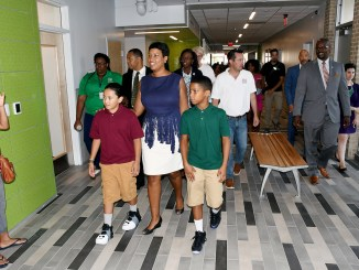 Mayor Muriel Bowser and D.C. Public Schools Chancellor Antwan Wilson both expressed excitement as they greeted student and led D.C. officials on a tour of the modernized Marie Reed Elementary School in Northwest on Aug. 21 opening of the 2017-18 school year. (Roy Lewis/The Washington Informer)