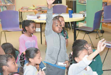 Eager schoolchildren participate in classroom activities. (Courtesy of DCPS)
