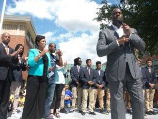 "Basketball legend Earvin ""Magic"" Johnson speaks at the Back-to-School Block Party on Sept. 9 at Ron Brown College Preparatory High School in northeast D.C. (Shevry Lassiter/The Washington Informer)"
