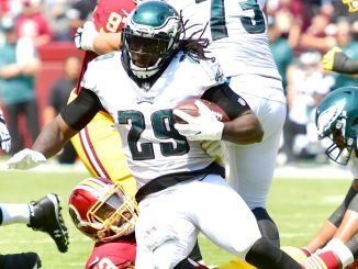 Philadelphia Eagles running back LeGarrette Blount is tackled by Washington Redskins linebacker Zach Brown during the Eagles' 30-17 win at FedEx Field in Landover, Md., on Sept. 10. (John E. De Freitas/The Washington Informer)