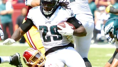 Philadelphia Eagles running back LeGarrette Blount is tackled by Washington Redskins linebacker Zach Brown during the Eagles' 30-17 win at FedEx Field in Landover, Md., on Sept. 10. (John E. De Freitas/The Washington Informer)