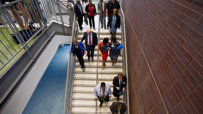 Prince George's County Executive Rushern L. Baker III tours the new Fairmount Heights High School in Hyattsville on Sept. 6, the first day of school. (Lateef Mangum/The Washington Informer)