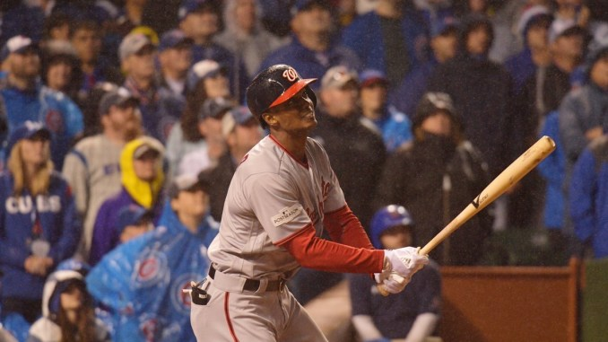 Washington Nationals center fielder Michael A. Taylor watches the ball leave the park after hitting a grand slam in the eighth inning of a 5-0 road win over the Chicago Cubs in Game 4 of the National League Division Series on Oct. 11. (Courtesy of the Nationals via Twitter)