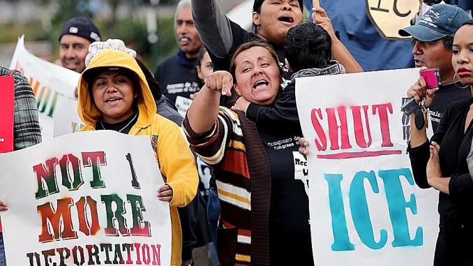 Demonstrators protest against ICE raids. (Courtesy of Al Jazeera America)