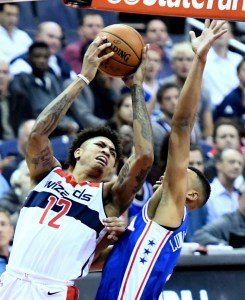 Washington Wizards forward Kelly Oubre Jr. attempts a shot over Philadelphia 76ers forward Timothe Luwawu-Cabarrot during the first quarter of the Wizards' 120-115 win at Capital One Arena in D.C. on Oct. 18. (John De Freitas/The Washington Informer)