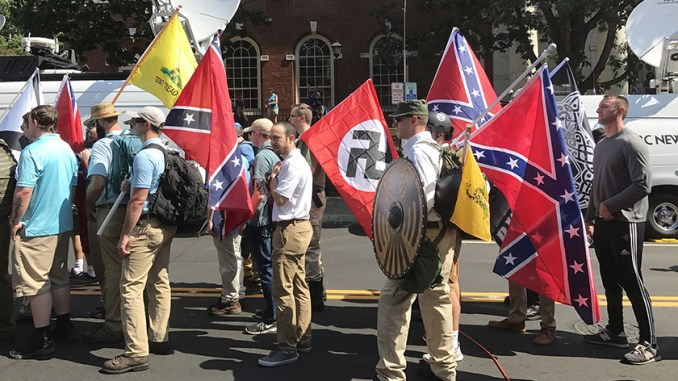 "Alt-right members prepare to enter Emancipation Park holding Nazi, Confederate, and Gadsden ""Don't Tread on Me"" flags in Charlottesville, Va. (Anthony Crider/Wikimedia Commons)"