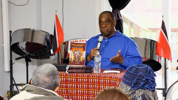 """Dozens gather at Sankofa bookstore in Northwest for a Nov. 19 public forum on Caribbean music, based on the new book """"Voices of Pan Pioneers of Trinidad & Tobago: A Global Legacy"""" by historian Von Martin. (E Watson/EDI Photo)"""