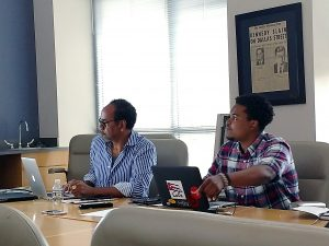 Tim Reid reviews video footage with his teaching assistant Duane Saunders Jr., a Morgan State University graduate and one of Reid's former students. (Brenda C. Siler/The Washington Informer)
