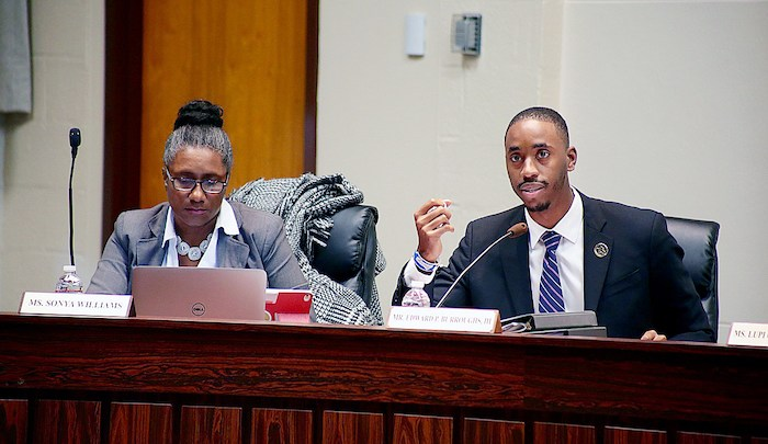 Prince George's County school board member Edward Burroughs III (right) discusses a performance audit at the school administration building in Upper Marlboro on Nov. 9, as school board member Sonya Williams listens. (Demetrious Kinney/The Washington Informer)