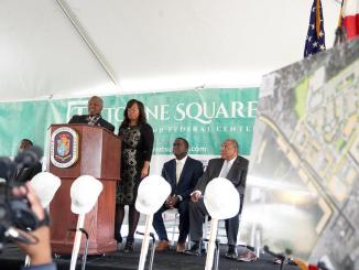 Prince George's County Executive Rushern Baker and District 7 County Council member Karen Toles speak during the groundbreaking of Suitland Towne Square, the $400 million residential and commercial project, at Suitland Federal Center on Nov. 16. (Mark Mahoney/The Washington Informer)