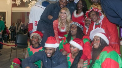 Members of the Georgetown basketball team, a few cheerleaders, and Georgetown basketball coach Patrick Ewing participate in Events DC Cozy Christmas partnering with the Washington Informer and the Washington Nationals on December 21. [Shevry Lassiter - The Washington Informer]