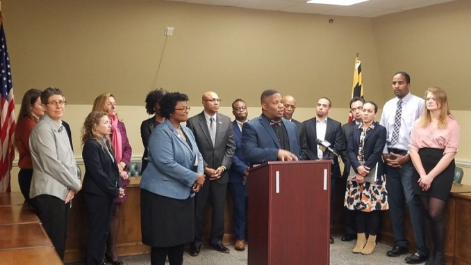 Dayvon Love (at podium) speaks during a Jan. 30 press conference in Annapolis against proposed crime bills from Maryland Gov. Larry Hogan, as Delegate Mary Washington (left) of Baltimore City looks on. (William J. Ford/The Washington Informer)