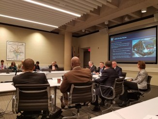A Metro committee recommended a program to offer rush hour commuters refunds if train or bus service runs late by 15 minutes or more during a Jan. 11 board meeting at the agency's D.C. headquarters. (William J. Ford/The Washington Informer)
