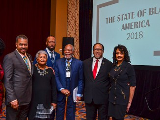 From left: Lisa Frison, the vice president of African American segment strategy at Wells Fargo; Julius Cartwright, the former president of National Association of Real Estate Brokers; Dorothy Leavell, the chairman of the NNPA; Reverend Tony Lee, the pastor of Community of Hope A.M.E. Church; Dr. Amos Brown, the pastor of the Third Baptist Church of San Francisco; Dr. Benjamin F. Chavis Jr., president and CEO of the NNPA; and Dr. Lezli Baskerville, the president and CEO of NAFEO pose for a photo during the NNPA's State of Black America 2018 Forum in Las Vegas. (Freddie Allen/AMG/NNPA)