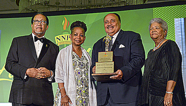 Martin Luther King III (second from right) is flanked by (from left) NNPA President Benjamin F. Chavis Jr., Washington Informer Publisher Denise Rolark Barnes and NNPA Chair Dorothy Leavell as he receives the 2017 NNPA Lifetime Legacy Award. (Freddie Allen/AMG/NNPA)