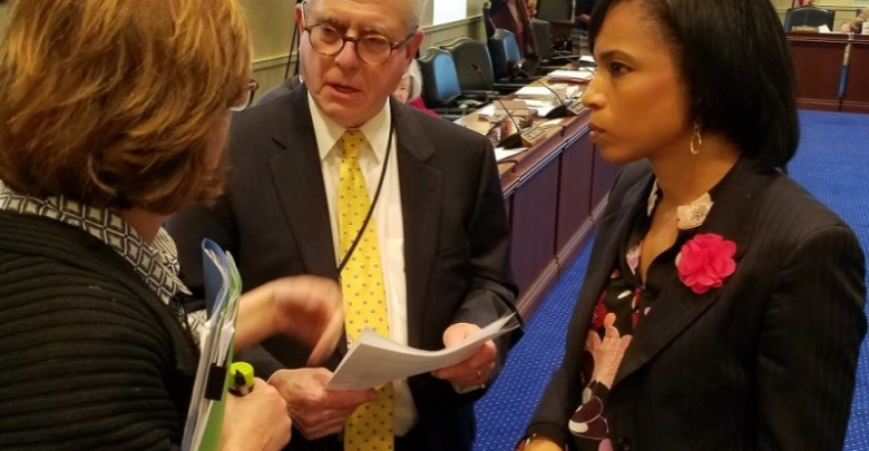 Prince George's County State's Attorney Angela Alsobrooks (right) and Anne Arundel County Assistant State's Attorney William Katcef review a bill to make solicitation to commit murder a felony in Maryland. (William J. Ford/The Washington Informer)