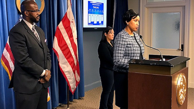 D.C. Public Schools Chancellor Antwan Wilson stands by as Mayor Muriel Bowser addresses the schools system's recent attendance scandal. (Courtesy of WTOP)