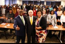 From left: Jim Coleman, EDC President and CEO, George C. Fraser, CEO of FraserNet, Inc., and Jennifer Jones, chair of Prince George's Commission for Women, pose for a photo during an EDC event for Prince George's County small-business owners on Feb. 15.
