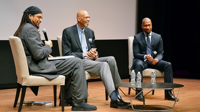 Former NBA player, activist and author Etan Thomas (left) chats with basketball legend Kareem Abdul-Jabbar (center) about his new book at the National Museum of African American History and Culture in D.C. on Feb.7. Damion Thomas, the museum's curator of sports, participates in conversation. (Brigette White/The Washington Informer)