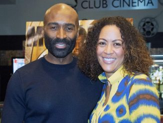 "Will Walters, publisher of Monarch magazine, and Dianne Wallace Booker, executive director of the U.S. Dream Academy, partnered to bring youth from the academy to the premiere of ""Black Panther"" at the Majestic Theater in D.C. on Feb. 18. (Shevry Lassiter/The Washington Informer)"
