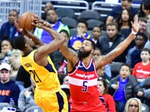 Washington Wizards forward Markieff Morris attempts to block a shot attempt by Indiana Pacers forward Thaddeus Young in the second quarter of the Wizards' 109-102 win at Capital One Arena in D.C. on March 17. (John De Freitas/The Washington Informer)