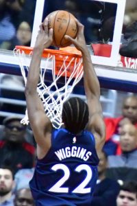 Minnesota Timberwolves forward Andrew Wiggins goes up for a dunk during Minnesota's 116-111 win over the Washington Wizards at Capital One Arena in D.C. on March 13. (John De Freitas/The Washington Informer)