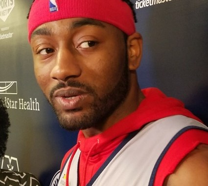 Washington Wizards point guard John Wall speaks with reporters inside Capital One Arena in D.C. on March 26. (William J. Ford/The Washington Informer)