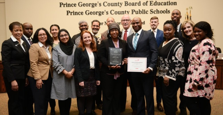 Prince George's County Public Schools CEO Keven Maxwell (center, red tie) joins local officials to honor three county schools that were recognized by the Alliance for a Healthier Generation Landmark. (Courtesy of PGCPS Board of Education)