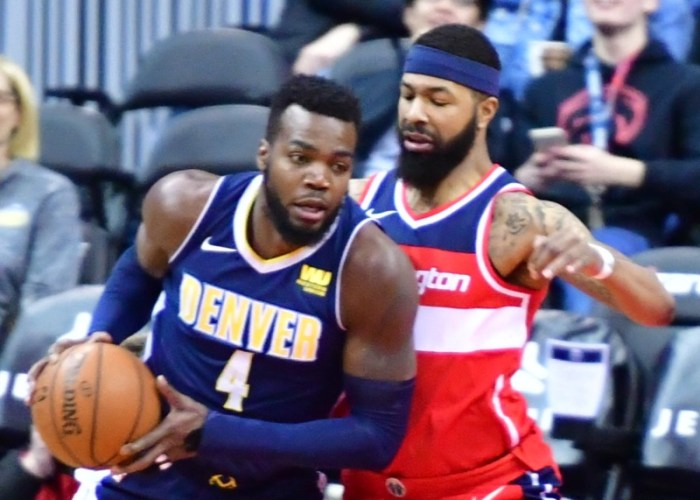 Denver Nuggets forward Paul Millsap posts up against Washington Wizards forward Markieff Morris during the Nuggets' 108-100 win at Capital One Arena in D.C. on March 23. (John De Freitas/The Washington Informer)
