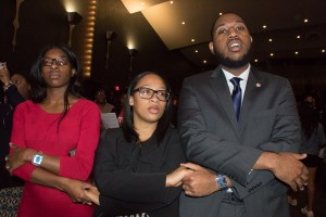 From left: Howard University students Kenae Damon, Jordan Jean and NaJah Banks attend the university's 2018 Charter Day Convocation at Cramton Auditorium on Howard's northwest D.C. campus on March 2. (Shevry Lassiter/The Washington Informer)
