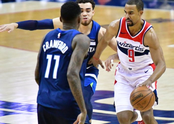 Washington Wizards guard Ramon Sessions drives past Minnesota Timberwolves guard Tyus Jones during Minnesota's 116-111 win at Capital One Arena in D.C. on March 13. (John E. De Freitas/The Washington Informer)