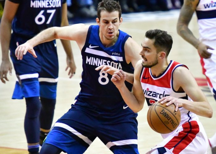 Washington Wizards guard Tomas Satoransky drives past Minnesota Timberwolves forward Nemanja Bjelica during Minnesota's 116-111 win at Capital One Arena in D.C. on March 13. (John E. De Freitas/The Washington Informer)