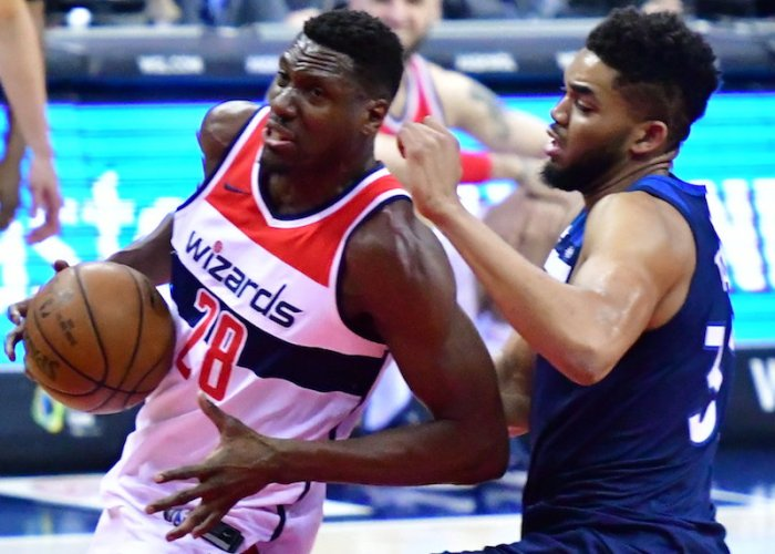 Washington Wizards center Ian Mahinmi drives past Minnesota Timberwolves center Karl-Anthony Towns during Minnesota's 116-111 win at Capital One Arena in D.C. on March 13. (John E. De Freitas/The Washington Informer)