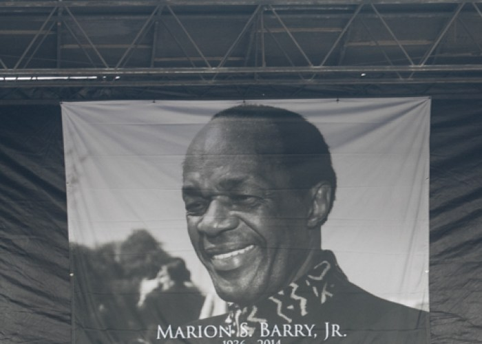 This poster of Marion Barry used as a backdrop on the stage for the statue unveiling on Pennsylvania Avenue Saturday, March 3. (Shevry Lassiter/The Washington Informer)