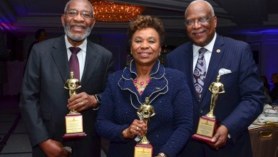 From left: Rev. Dr. Amos C. Brown, a student of Dr. Martin Luther King Jr. and pastor of the Third Baptist Church of San Francisco, Rep. Barbara Lee (D-Calif.) and James Farmer of General Motors receive Torch Awards during a Black Press Week ceremony in D.C. (Freddie Allen/AMG/NNPA)