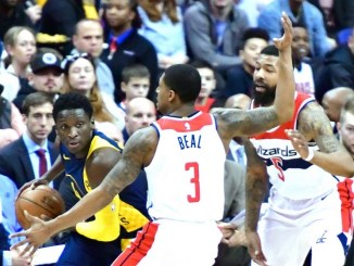 Indiana Pacers guard Victor Oladipo fends off a double-team by Washington Wizards guard Bradley Beal (3) and forward Markieff Morris during the Pacers' 98-95 win at Capital One Arena in northwest D.C. on March 4. (John De Freitas/The Washington Informer)