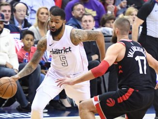 Washington Wizards forward Markieff Morris drives against Toronto Raptors center Jonas Valanciunas during the Wizards' 106-98 win in Game 4 of the Eastern Conference first-round playoff series at Capital One Arena in D.C. on April 22. (John E. De Freitas/The Washington Informer)