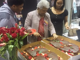 NNPA Chairman Dorothy R. Leavell cuts the cake at the Black Women's Expo in Chicago in celebration of her 50th anniversary as publisher of the Chicago and Gary Crusader newspapers. (Chicago Crusader)