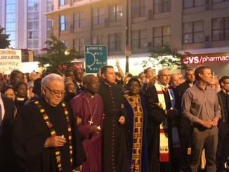 Bishop Michael Curry (second from left) leads a silent vigil from National City Christian Church to Lafayette Square near the White House in D.C. on May 24. (Hamil R. Harris/The Washington Informer)