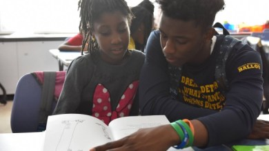 """The """"Reach Incorporated"""" program aims to develop confident elementary school readers via tutoring by high school students. (Courtesy of DCPS)"""