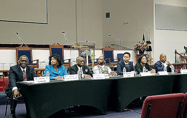 From left: Prince George's County Council at-large candidates Melvin Johnson, Juanita Culbrith-Miller, Councilman Mel Franklin, Reginald Tyer, Julian Lopez, Gerron S. Levi and Calvin Hawkins participate in a May 19 candidates' forum at Greater Mt. Nebo AME Church in Bowie. (William J. Ford/The Washington Informer)
