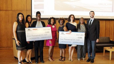 Winners of the Boom Conference's Business Pitch competition are congratulated by judges and sponsors. From left: Samira Cook Gaines, founding partner of Global Empowerment Solutions and competition judge; Marguerita M. Cheng, CEO of Blue Ocean Global Wealth and competition judge; Charlene Brown, ReciproCare founder and competition awardee; Angela Heath, founder of the Boom Conference; Felicia Brown of competition sponsor AARP; Judy O'Connor, Like Neighbors founder and competition awardee; Lorette Farris, CEO of iBoss, Inc., and competition coach; and Grier Melick, small business consultant at the Maryland Small Business Development Center and competition judge. (Brigette White/The Washington Informer)
