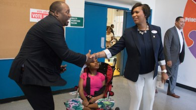 D.C. Mayor Muriel Bowser greets supporters at the Shepherd Elementary School in Northwest after casting her vote in the city's primary election on June 19. Bowser, seeking re-election, won the primary by receiving more than 80 percent of the vote. (Shevry Lassiter/The Washington Informer)